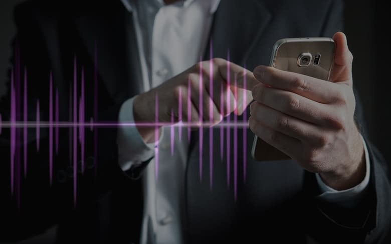 Man Touching on There Smartphone to use AI Powered Speech Tools