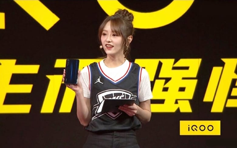 A Girl Showing IQOO Smartphone From Vivo Showcase