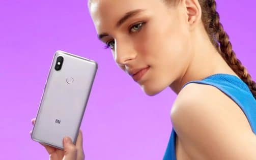 A Girl Holding Redmi Phone