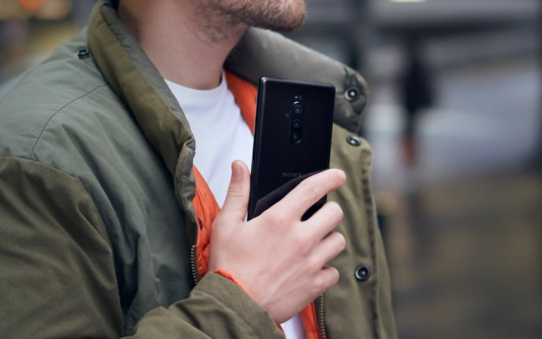 Man are Holding Sony Xperia 1 Mobile