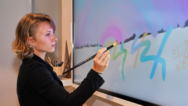 A Women is Painting at Samsung Flip Display