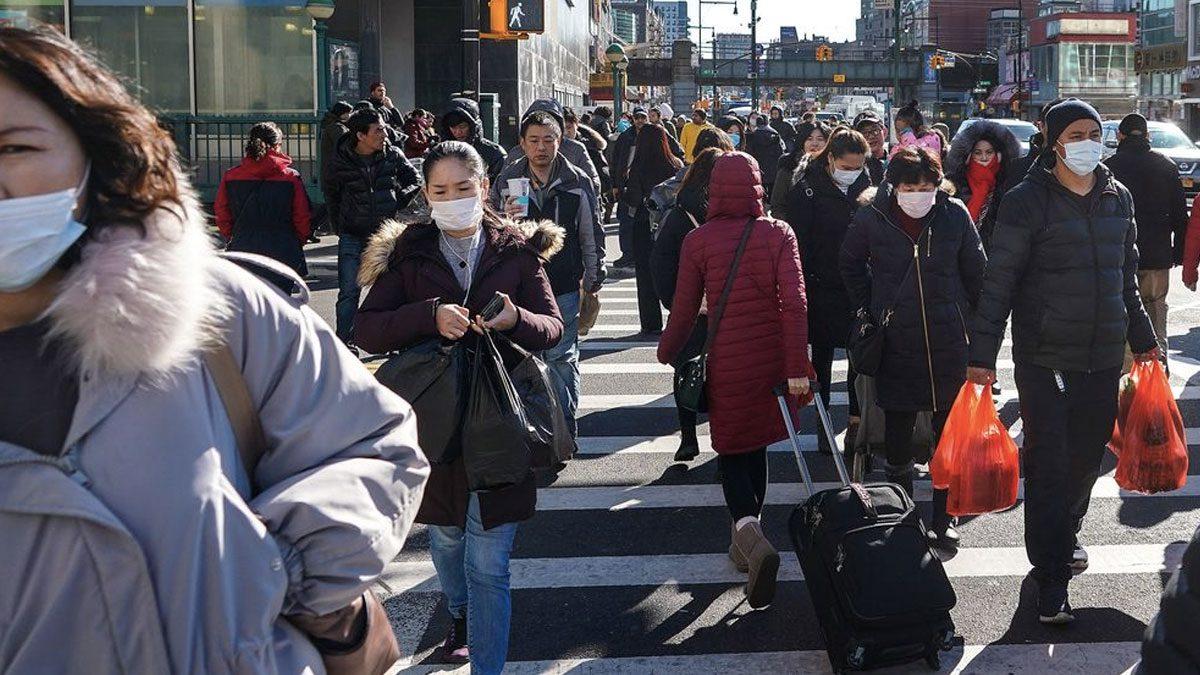 Pedestrians walking in Queens