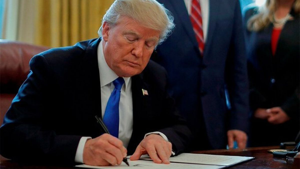 Trump Signing The Paper