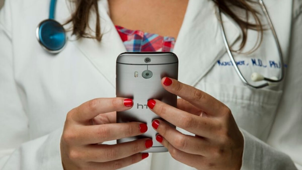 Doctor Using Mobile Phones