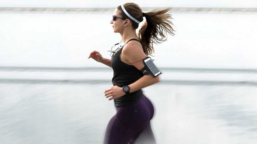 A Girl Jogging With A Smartphone