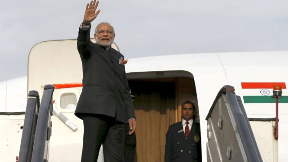 Prime Minister Waving Outside The Plane
