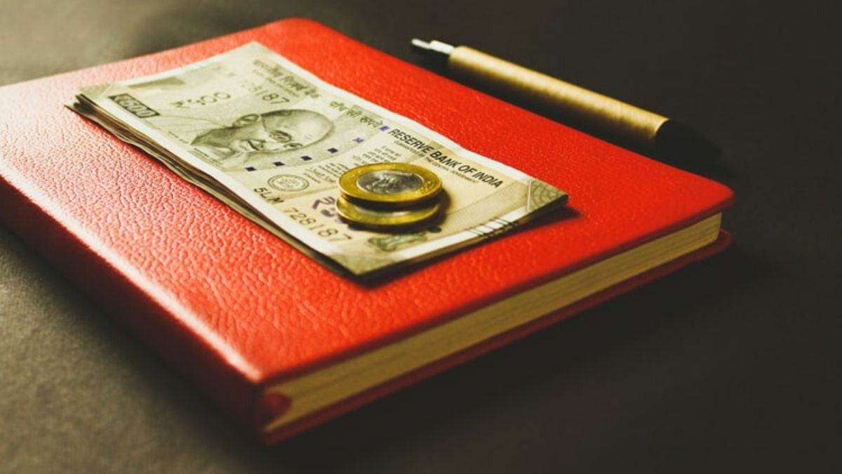 Rupees, Coins, Book And Pen