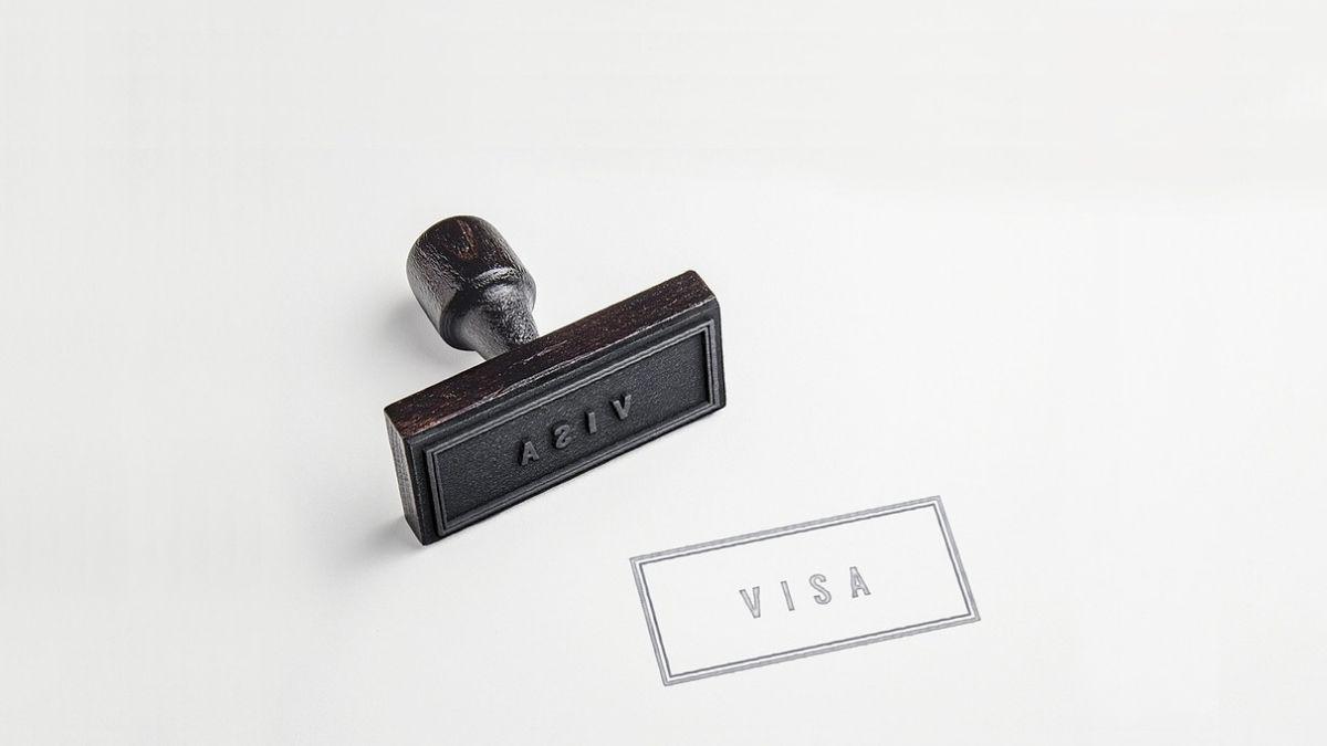 A Woman Stamping VISA