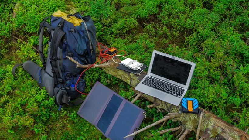 Laptop, Solar Charger And A Power Bank