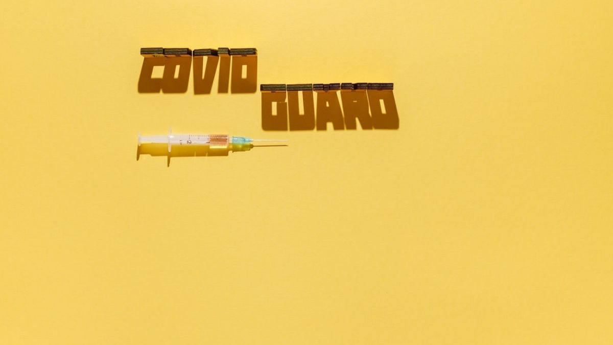 COVID Guard Text In Yellow Background