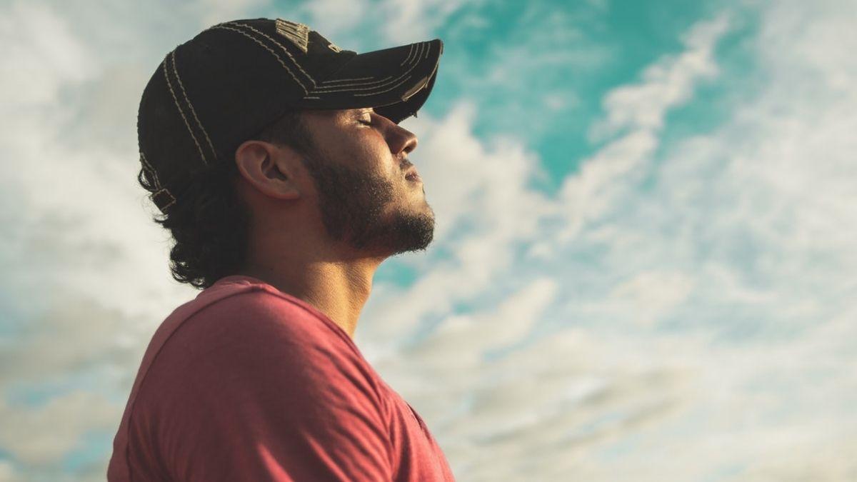 Man Breathing In Cloudy Sky