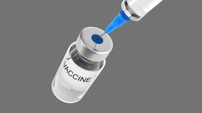 Vaccine Bottle And Syringe In Grey Background