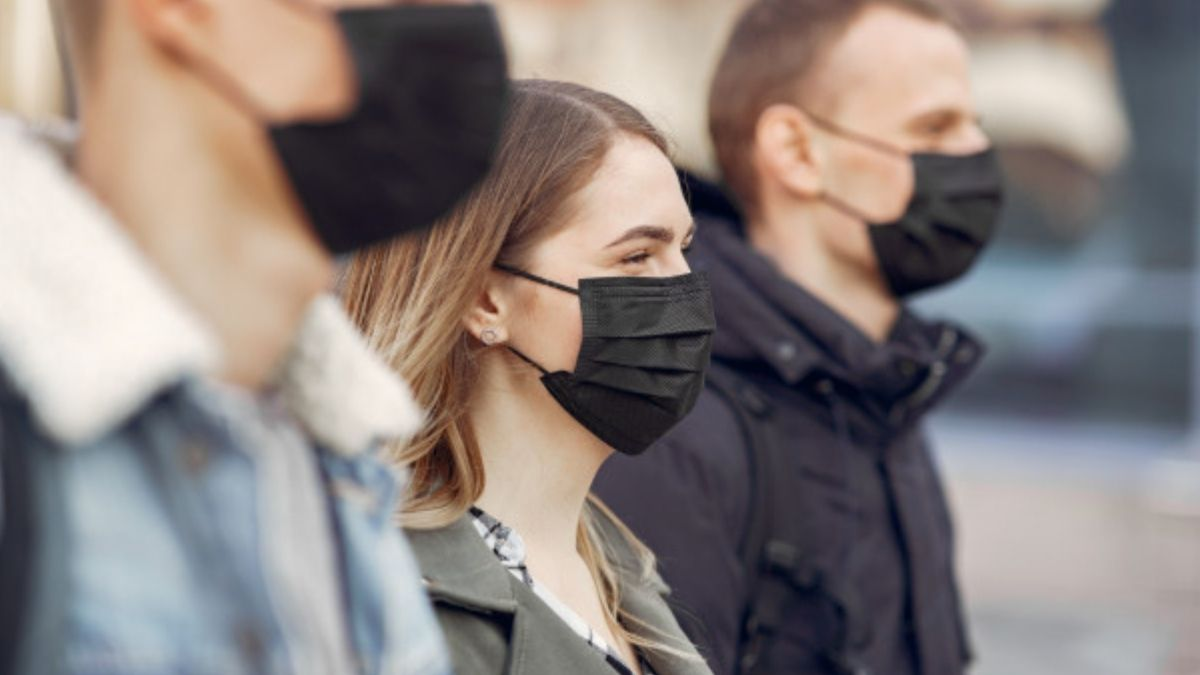 People Wearing Masks Standing On Streets