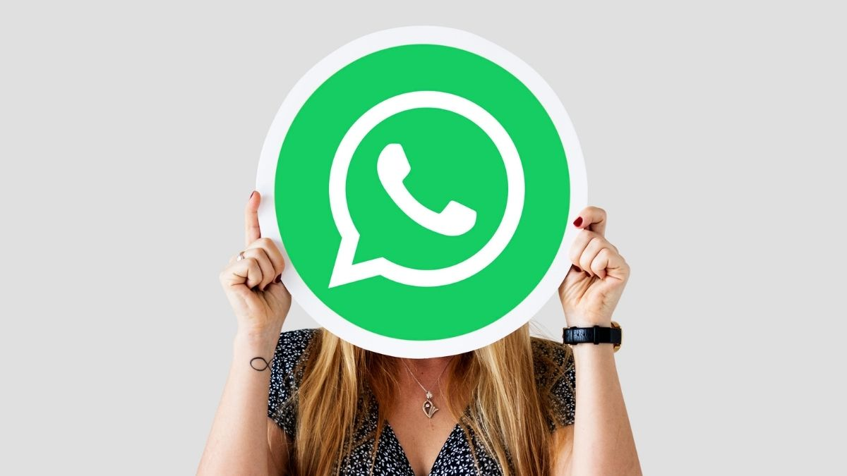 Woman Showing WhatsApp Messenger Icon