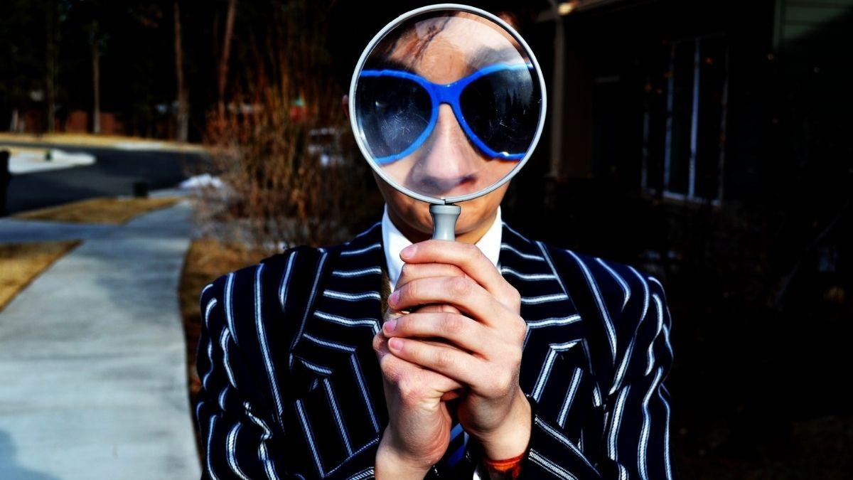 A Woman Viewing Through Lens