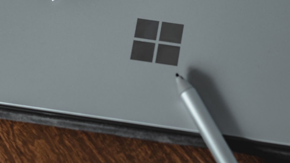 Microsoft Logo And Pencil