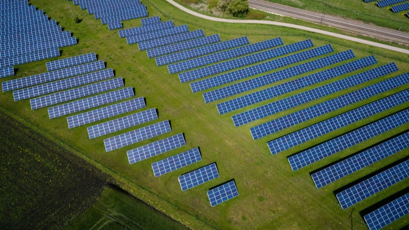 Grass Field With Blue Solar Panels