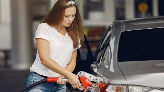 Woman Filling Fuel In Vehicle