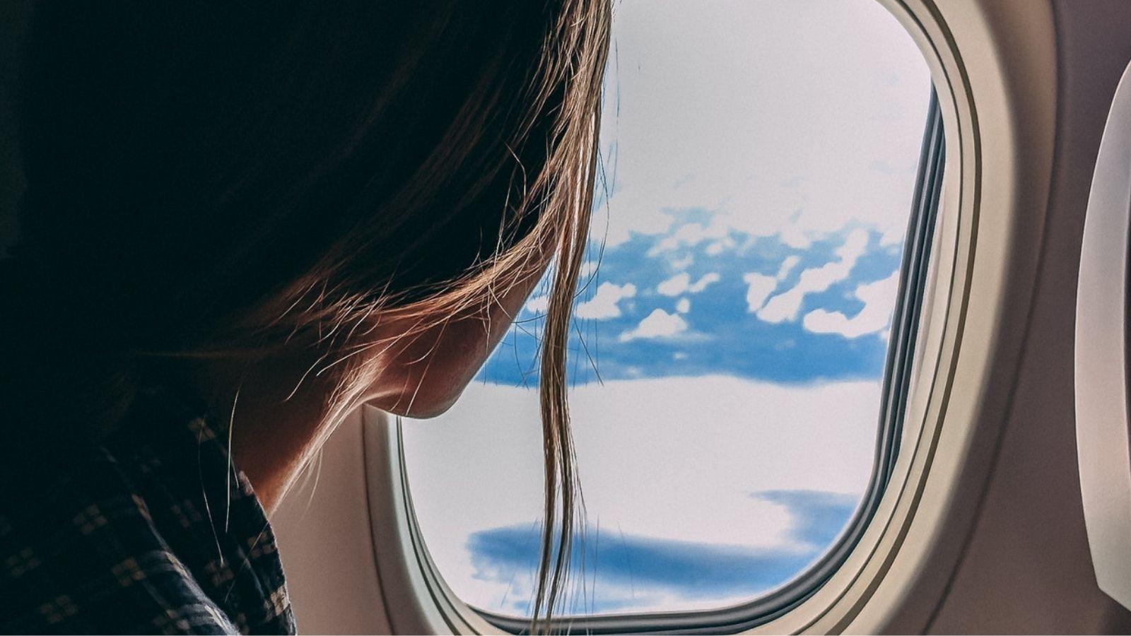 Woman Seeing Outside Airplane Window