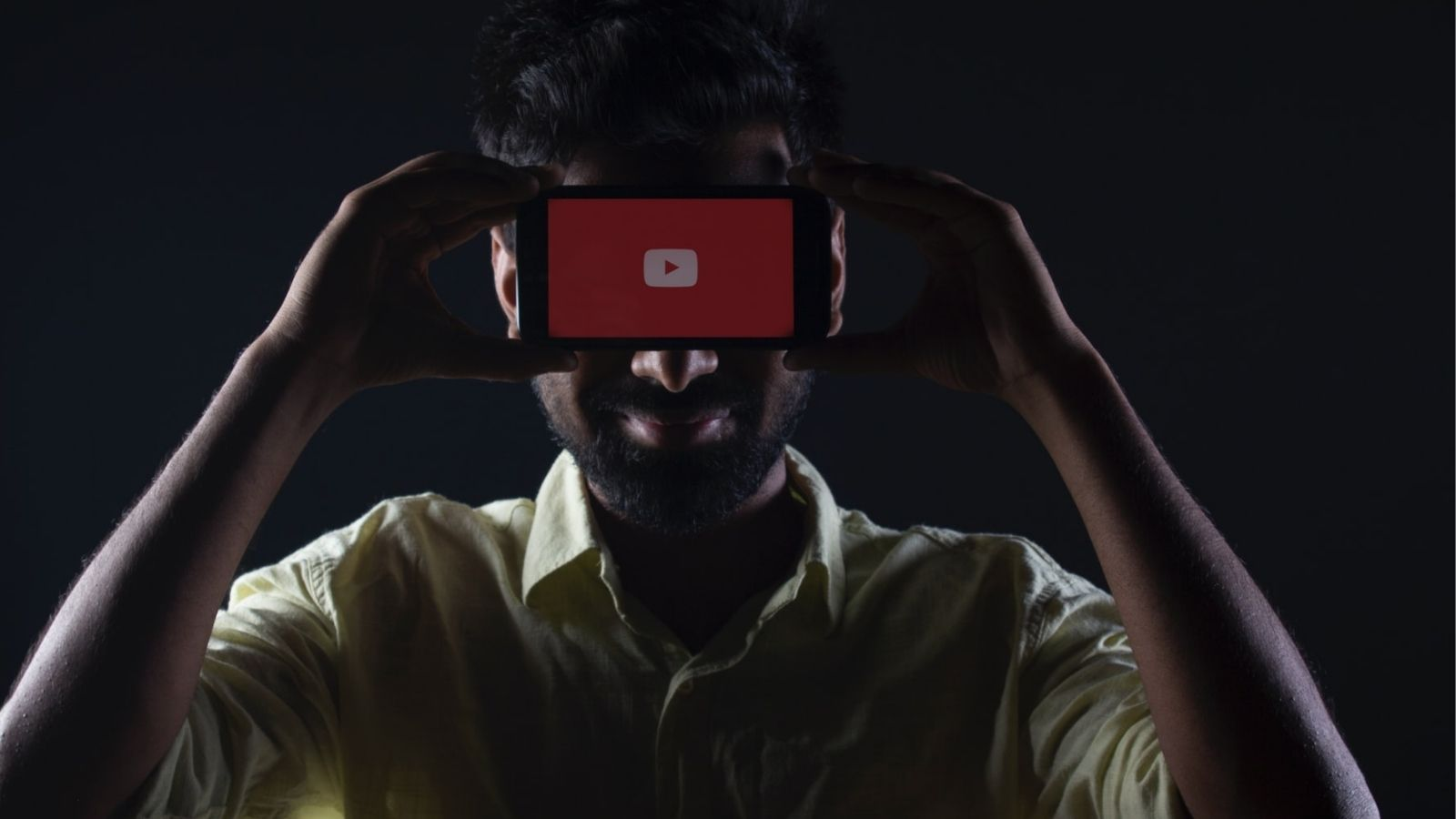 Person Holding YouTube App