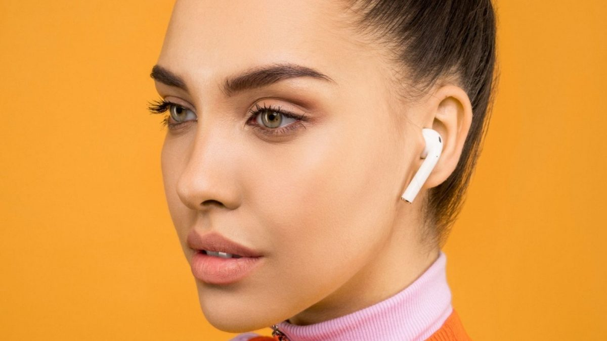 Woman Using Earbuds