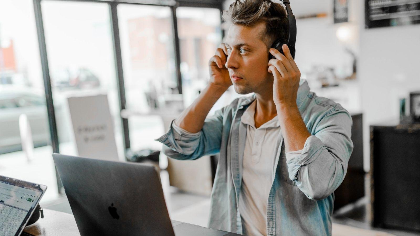 Man Using Headset On Macbook